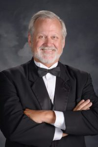 Travis Angel has 40 years of choral conducting experience before coming to Texas A&M University to become the Interim Assistant Director of Choral Activities. Mr. Angel has a Bachelor of Music Education and Master of Arts in Conducting from West Texas State University. He has studied and collaborated with conductors Hugh Sanders, Eph Ely, Paul Salamunovich, Bev Hensen, and Rene Clausen. Mr. Angel taught in Texas Public Schools at the High School level where his choirs earned numerous awards for their performances. He retired from teaching in 2015 but still remains active in mentoring teachers, serving as clinician for choirs, adjudicating contests and serving as Minister of Music at Christ's Way Baptist Church. Memberships include Texas Music Educators Association, Texas Choral Directors Association, American Choral Directors.
